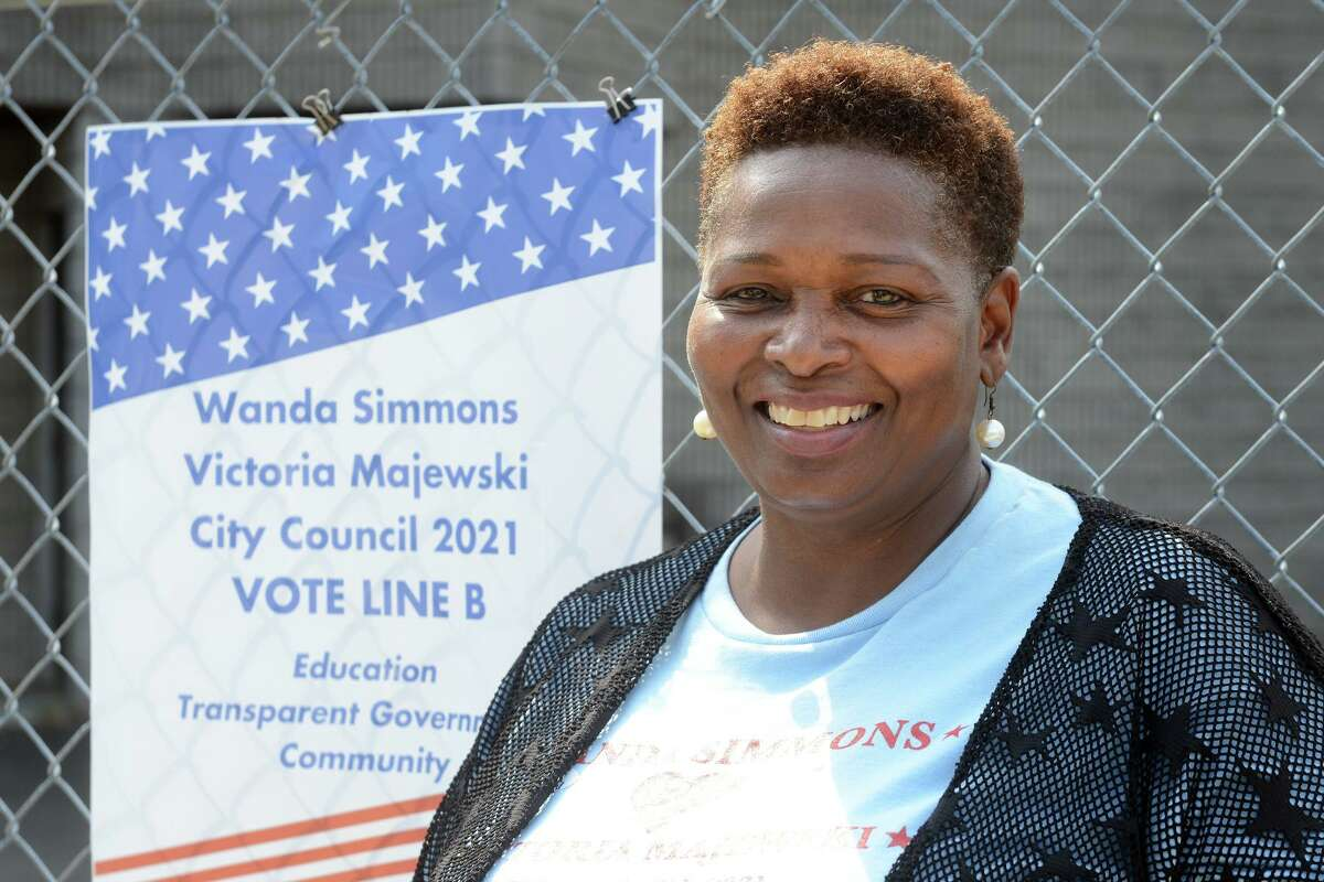 Candidate Wanda Simmons poses outside Dunbar School, in Bridgeport, Conn. Sept. 14th, 2021. Simmons is seeking to represent the 139th district.