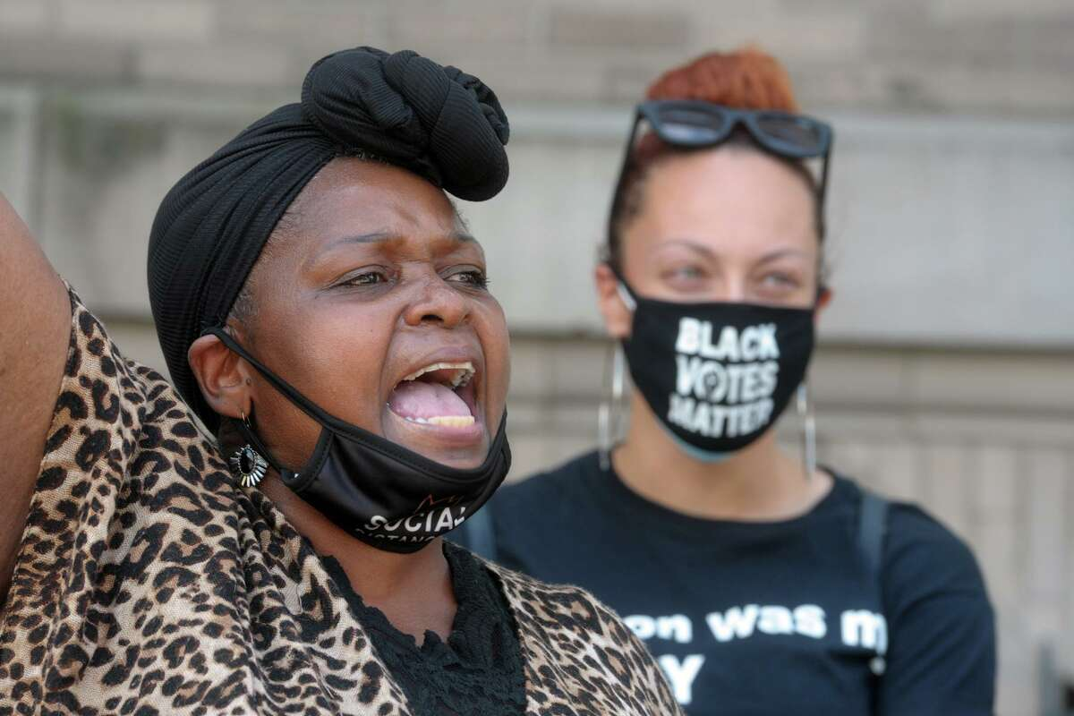 Wanda Simmons, Education Chairperson for the Greater Bridgeport NAACP, speaks at a rally in front of City Hall, in Bridgeport, Conn. July 13, 2020.