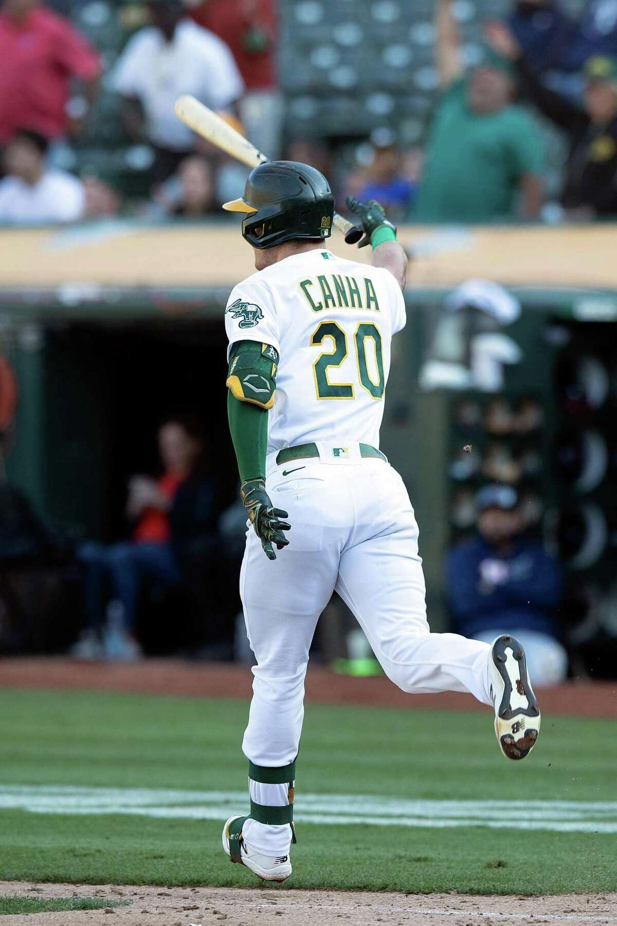OAKLAND, CALIFORNIA - SEPTEMBER 26: Mark Canha #20 of the Oakland Athletics flips his bat after hitting a walk-off single against the Houston Astros in the ninth inning at RingCentral Coliseum on September 26, 2021 in Oakland, California. The Athletics won 4-3. (Photo by Jason O. Watson/Getty Images)