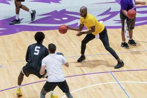 University at Albany men's basketball head coach Dwayne Killings passes the ball to a player as he is seen working with the team during his first official practice on Tuesday, Sept. 28, 2021 in Albany, N.Y.