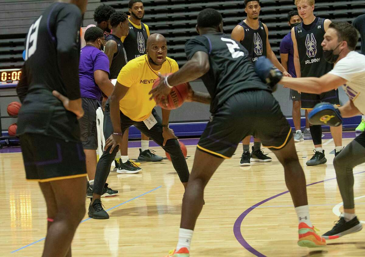 University at Albany men's basketball head coach Dwayne Killings, yellow shirt, will have his team ready to go at 7 p.m. for home games this season, with two exceptions, Jan. 15 vs. NJIT and Feb. 19 vs. New Hampshire, when they will play at 4 p.m.