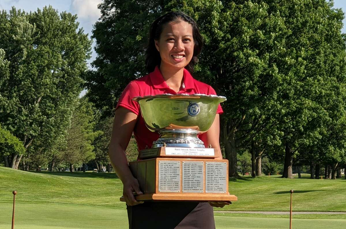 Midland's Kim Dinh poses with the trophy after winning the 105th Michigan Women's Amateur Championship at Saginaw Country Club on June 18, 2021. Dinh reached the Round of 16 at the U.S. Women's Mid-Amateur this week before losing a close match on Tuesday afternoon.