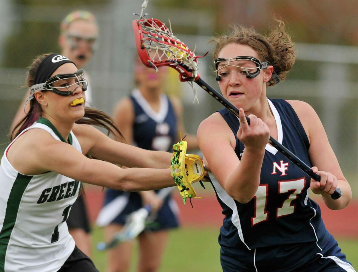 Nicole Vengalli, right, runs with the ball during a 2012 New Fairfield High School lacrosse game.