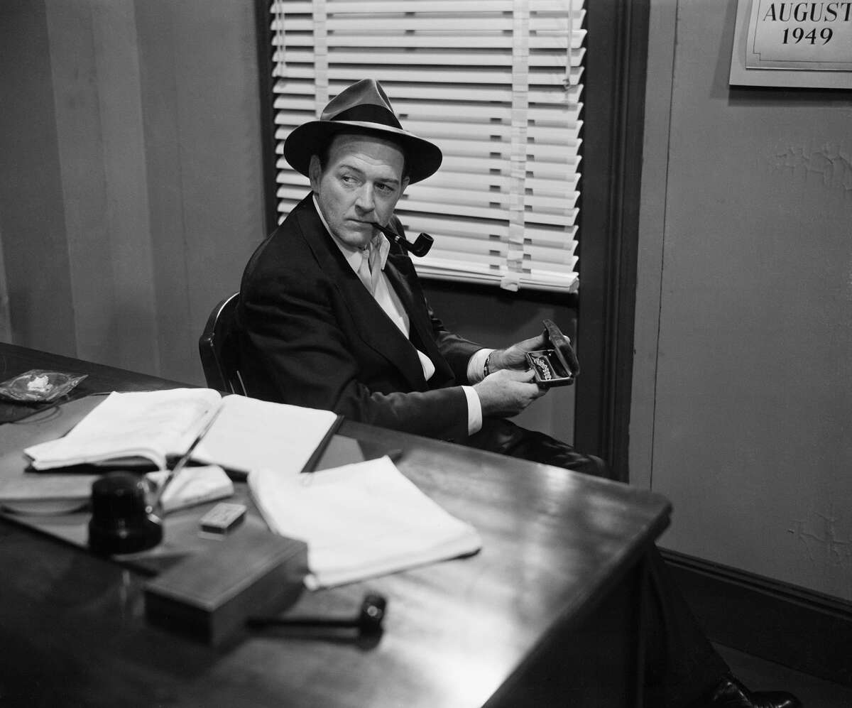 """William """"Bill"""" Gargan as Martin Kane in the television and radio drama """"Martin Kane, Private Eye,"""" September 1949. (Photo by NBCU Photo Bank/NBCUniversal via Getty Images via Getty Images)"""