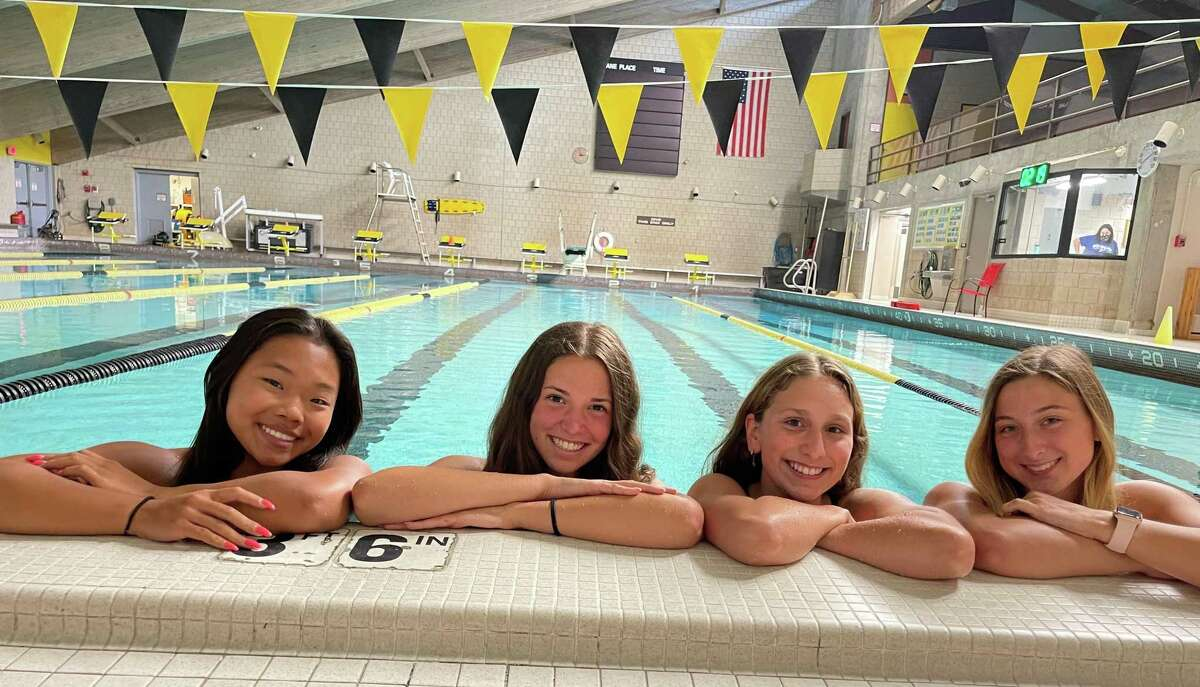 Amity's Katie O'Connor, Taylor Dillon, Julia Snow and Lauren Sender are swim and dive team captains for coach Todd Rainey.