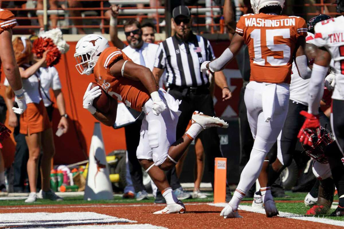 Bijan Robinson is the headline running back, but reserve Roschon Johnson (2) remains a vital piece of UT's dynamic offense.