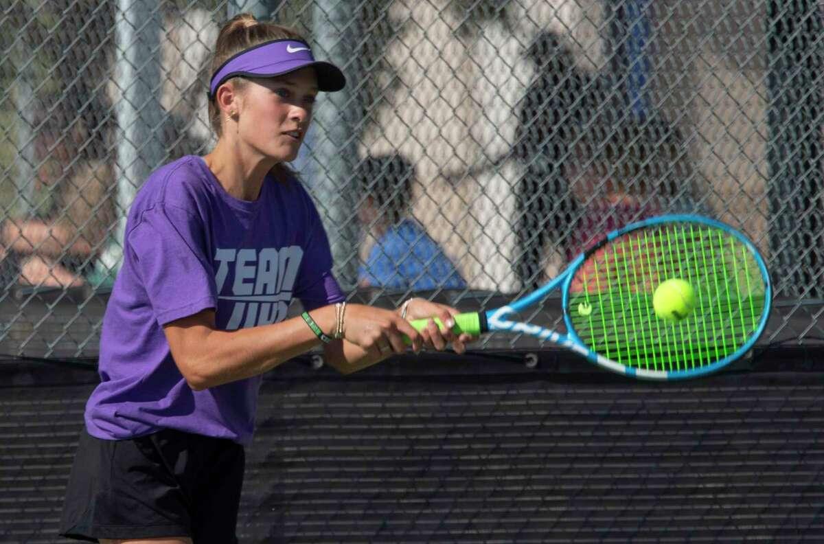 Midland High's Sarah Stewart returns a shot against Legacy High players during doubles play with Montserrat Salazar 09/28/2021 at the Bush Tennis Center. Tim Fischer/Reporter-Telegram