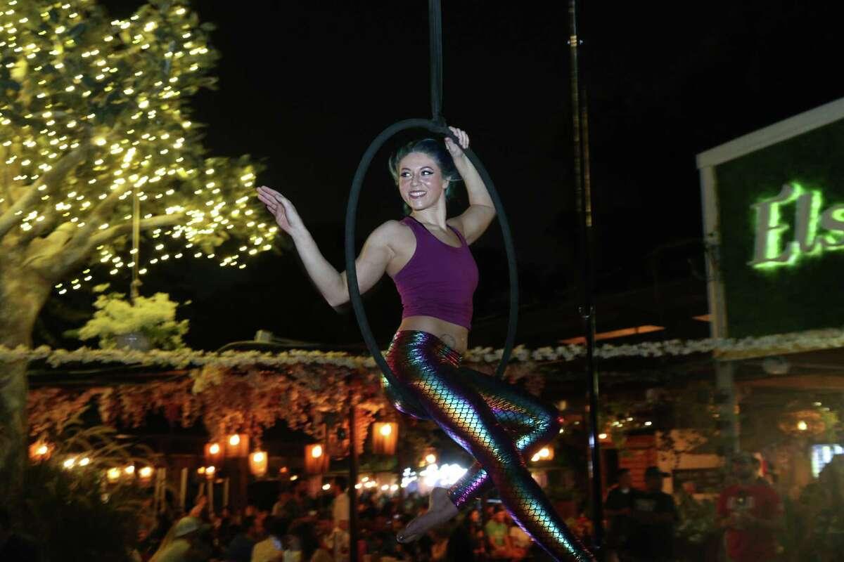 Michelle Kaplowitz performing on aerial ropes at Elsewhere Garden Bar & Kitchen.