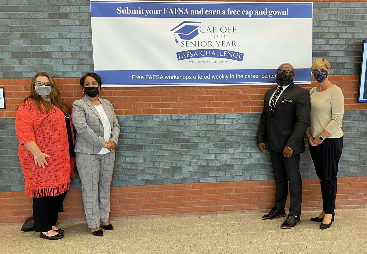 P-TECH Norwalk was one of four Connecticut schools to receive the Commissioner's Award for the 2021 Connecticut Free Application for Federal Student Aid. Pictured are Debra Costello, school counselor at P-TECH, P-Tech Principal Karen Amaker,Dr. Thomas McBryde, Norwalk Public School's deputy superintendent of excellence, equity and inclusion, andJennifer Barahona, CEO of Norwalk Acts.