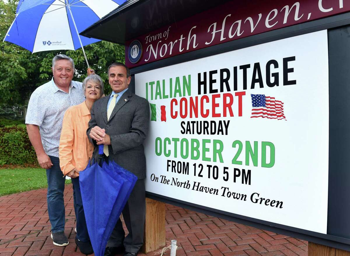 From left, Nick Casella, co-chair of the Italian Heritage Concert, Laura Florio Luzzi, chairwoman of the Greater New Haven Italian American Heritage Committee, and North Haven First Selectman Michael Freda are photographed Tuesday on the North Haven Green.
