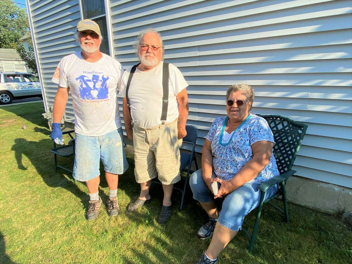 St. Raphael Parish in Milford team up with HomeFront to help a family in Milford fix their home. Pictured, from left, is St. Raphael Volunteer House Captain John Marmolejo with beneficiaries Pasquale and Sally Onofrio.