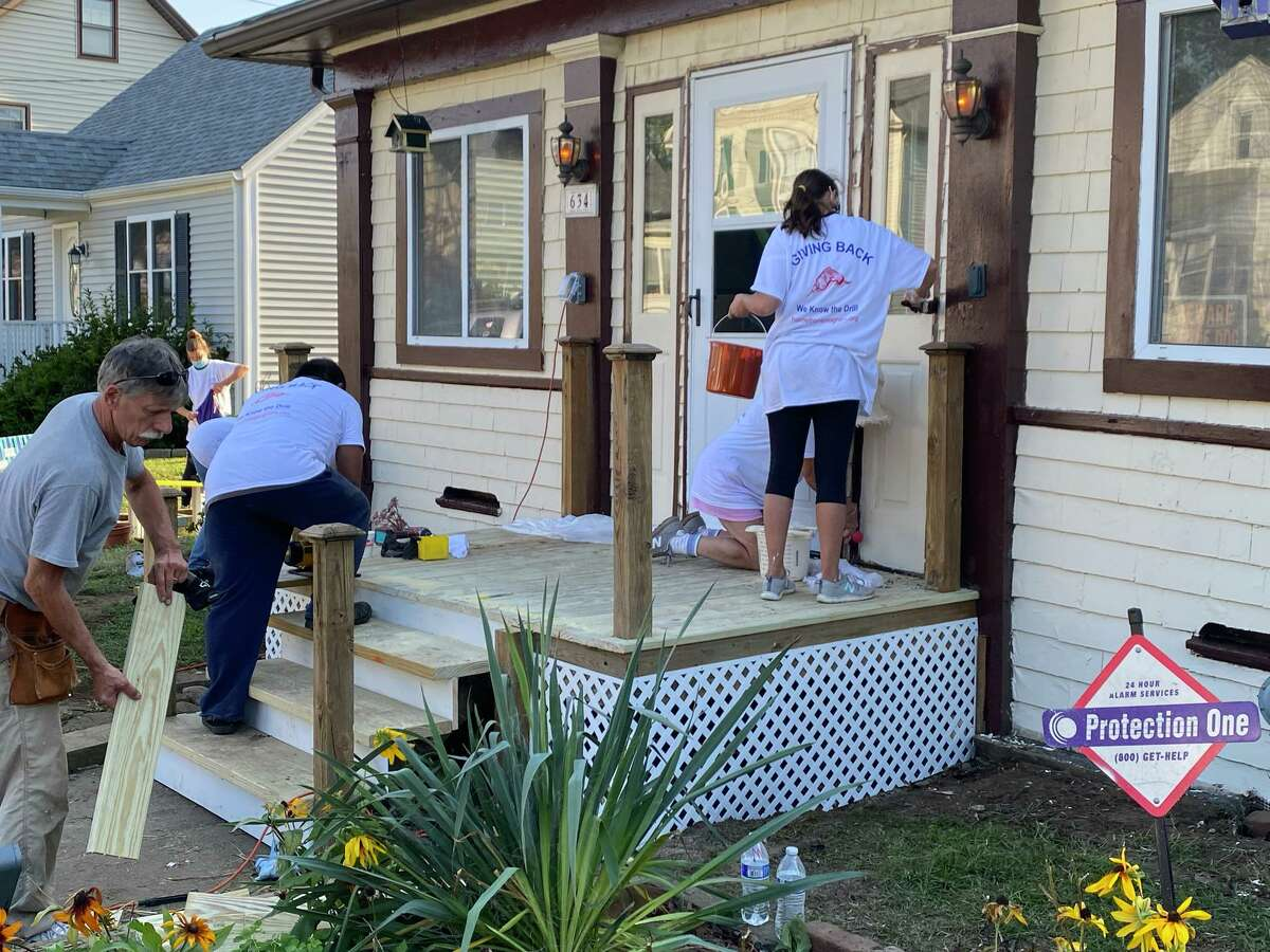 St. Raphael Parish in Milford team up with HomeFront to fix the home of Pasquale and Sally Onofrio of Milford. Pictured is St. Raphael volunteers working on the front steps.