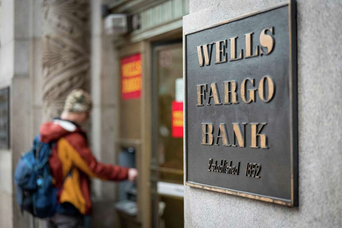 A customer uses an ATM machine in front of a Wells Fargo Bank branch in San Francisco, Calif. on Friday, Feb. 8, 2019.