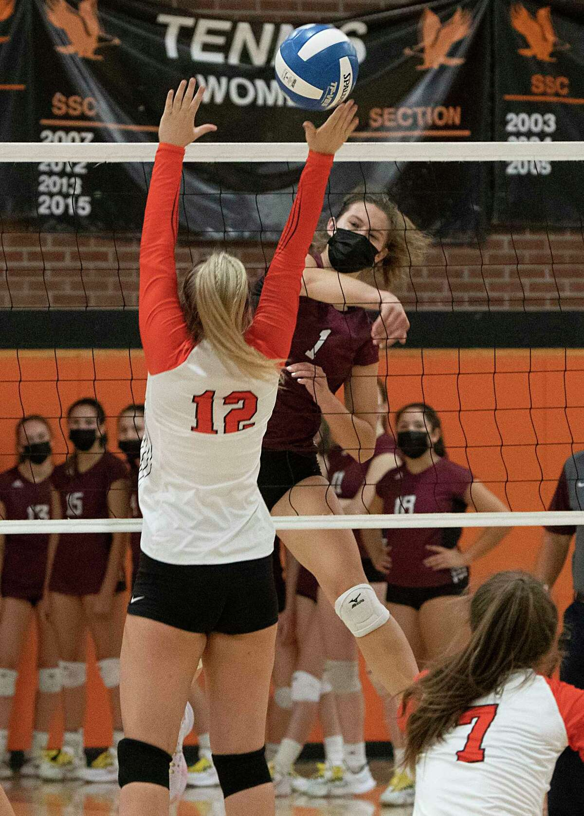 Burnt Hills' Carlie Rzeszotarski, right, spikes the ball past Bethlehem's Madeline Rounds in a match last week.