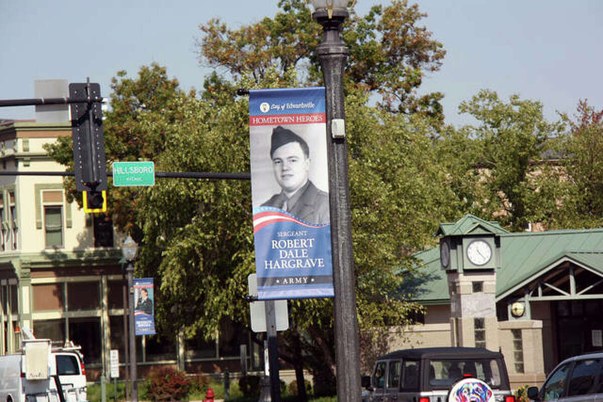 One of the 123 Veterans Day banners that will hang on city light poles until mid-November.