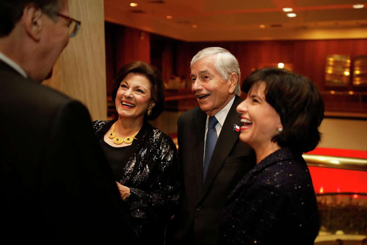 From left, Nadine Craddick, State Representative Tom Craddick, and Texas Railroad Commissioner Christi Craddick, share a laugh with Texas Lieutenant Governor Dan Patrick (foreground left) during the Permian Basin Petroleum Association's Top Hand award banquet honoring S. Javaid Anwar at the Petroleum Club.