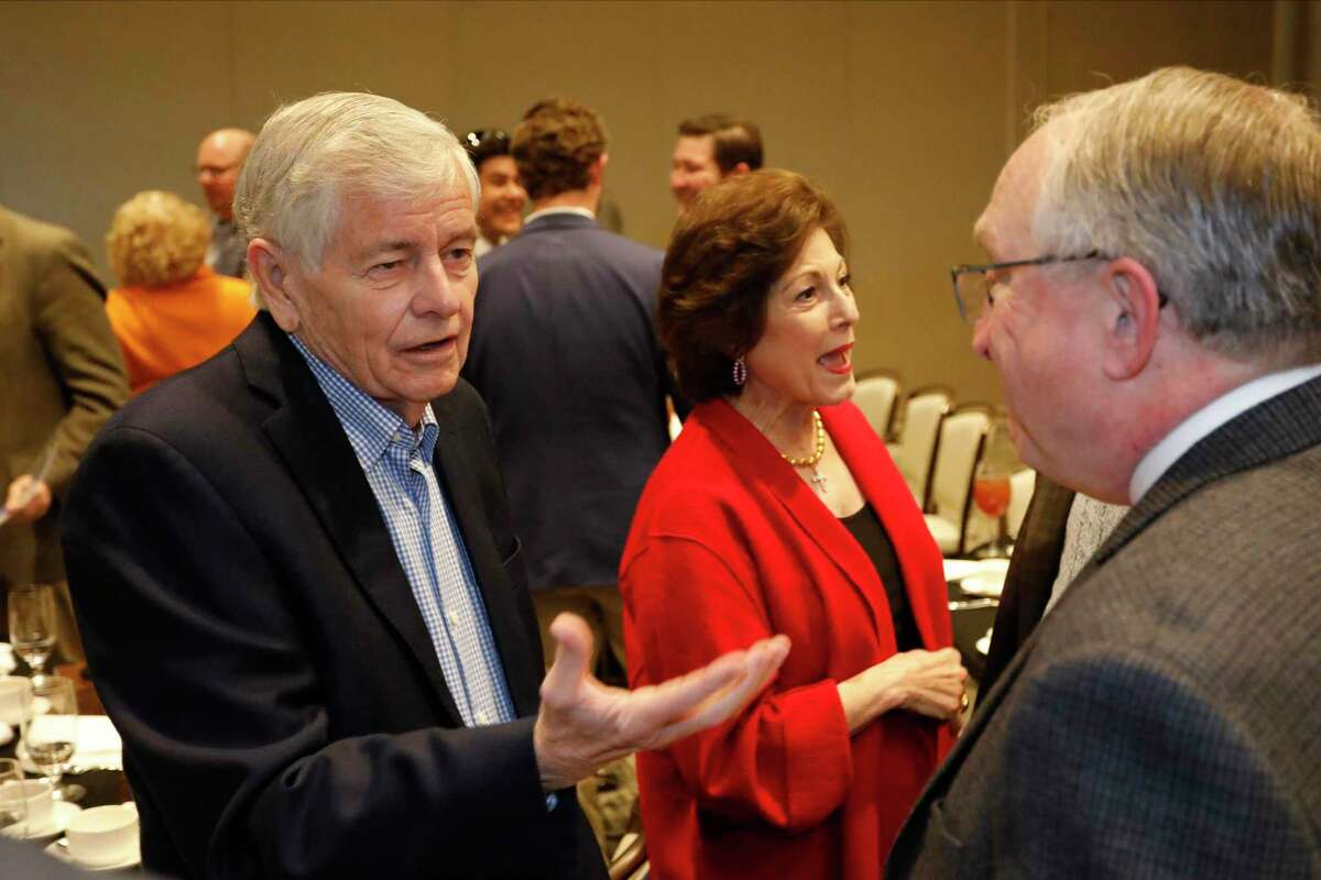 State Rep. Tom Craddick talks with Scott Speed, P.E., Odessa District Engineer for the Texas Department of Transportation, during the Midland-Odessa Transportation Alliance annual meeting at the Odessa Marriott Hotel and Conference Center. In background is Nadine Craddick.