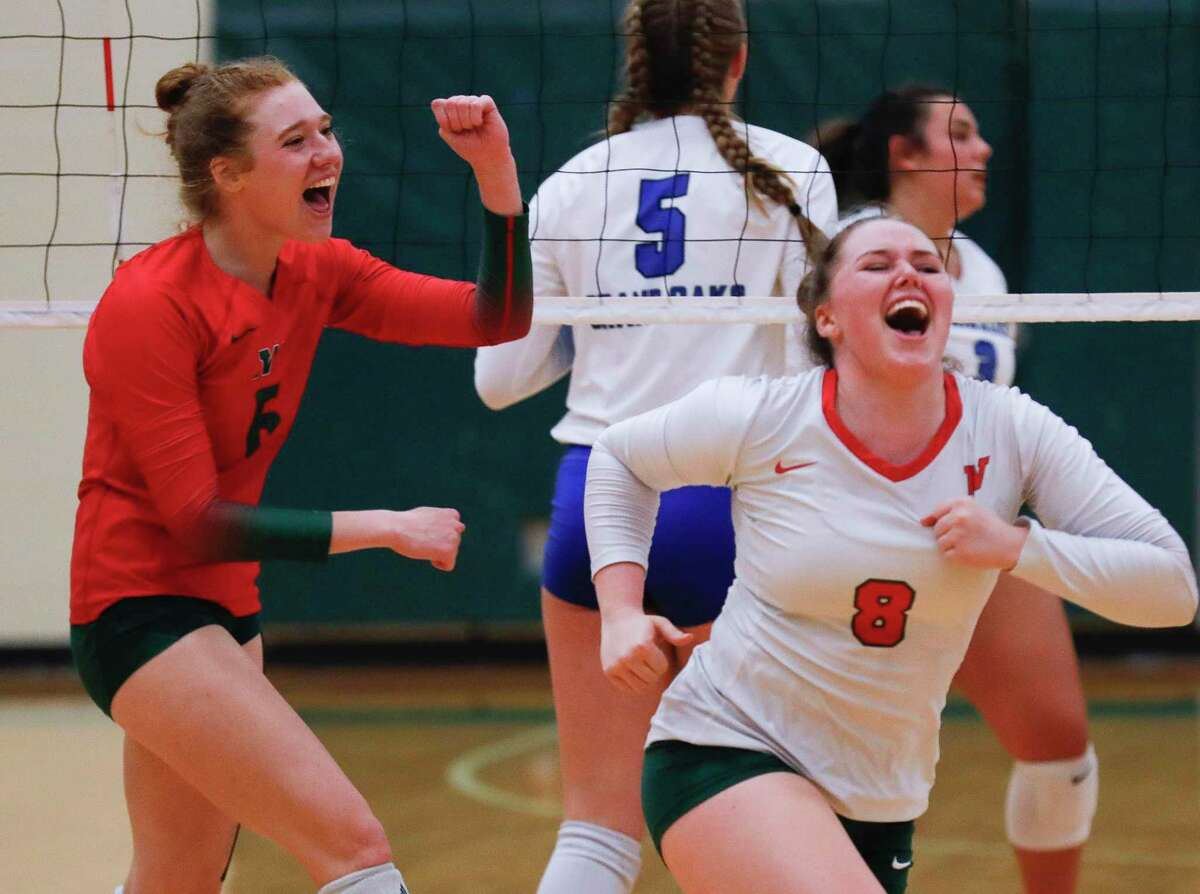 The Woodlands' Mary Claire Ristroph (15) celebrates after scoring a point beside Cassidy MacLean (8) during the first set of a high school volleyball match at The Woodlands High School, Tuesday, Sept. 28, 2021, in The Woodlands.