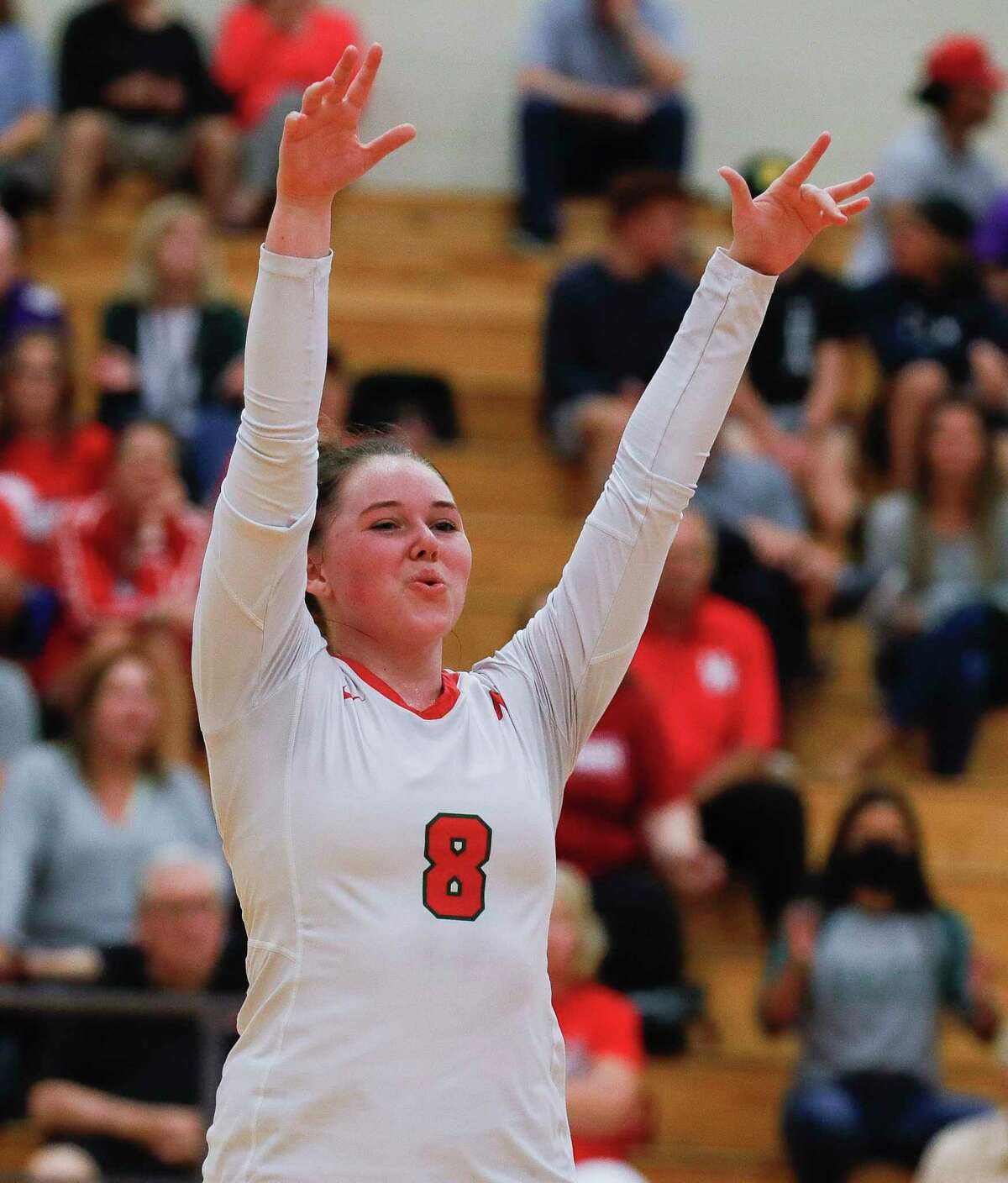 The Woodlands' Cassidy MacLean (8) reacts after a blocked shot during the first set of a high school volleyball match at The Woodlands High School, Tuesday, Sept. 28, 2021, in The Woodlands.