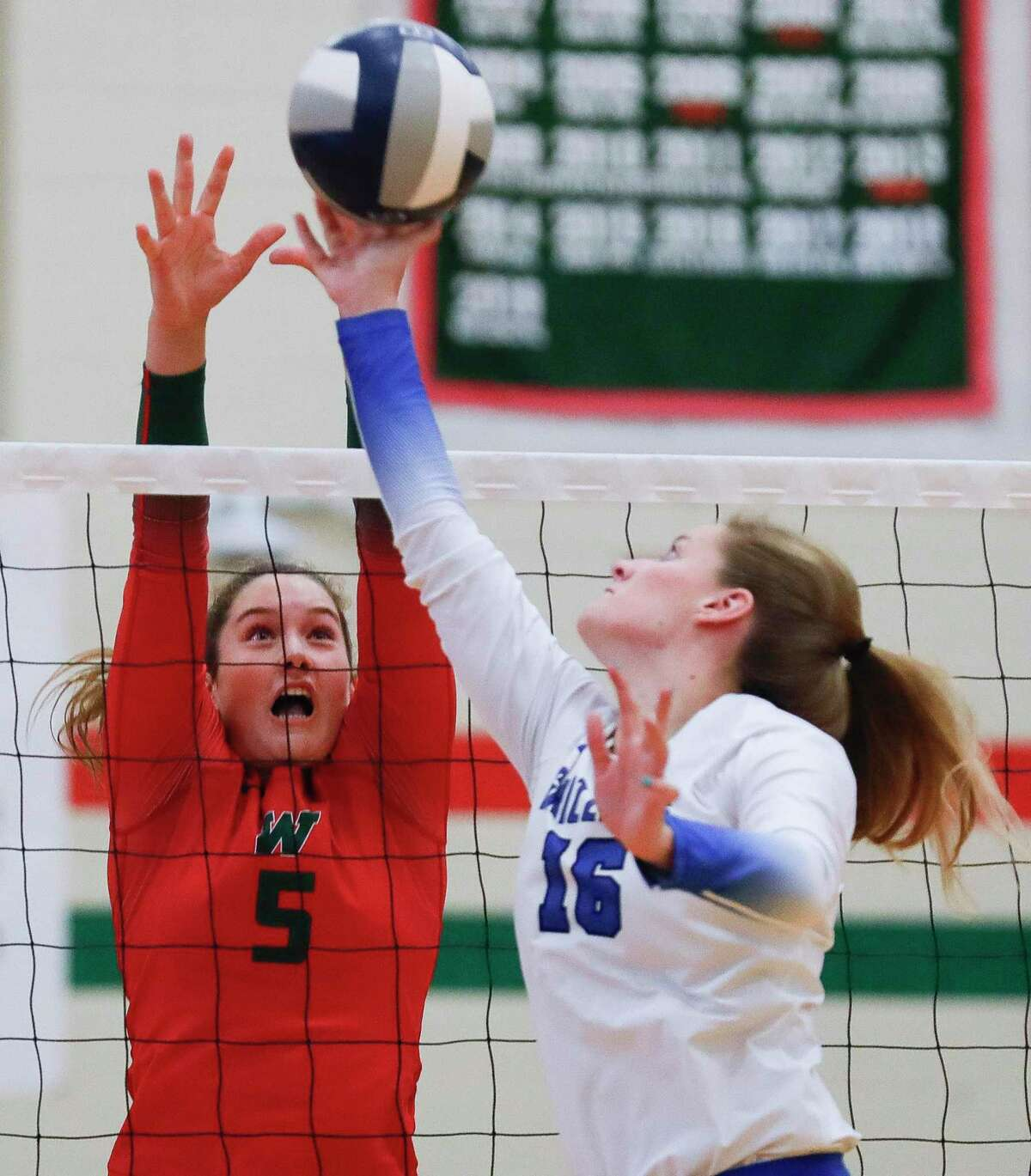 The Woodlands' Ella Lewis (5) pressures a tip from Grand Oaks' Aidan Ballard (15) during the first set of a high school volleyball match at The Woodlands High School, Tuesday, Sept. 28, 2021, in The Woodlands.