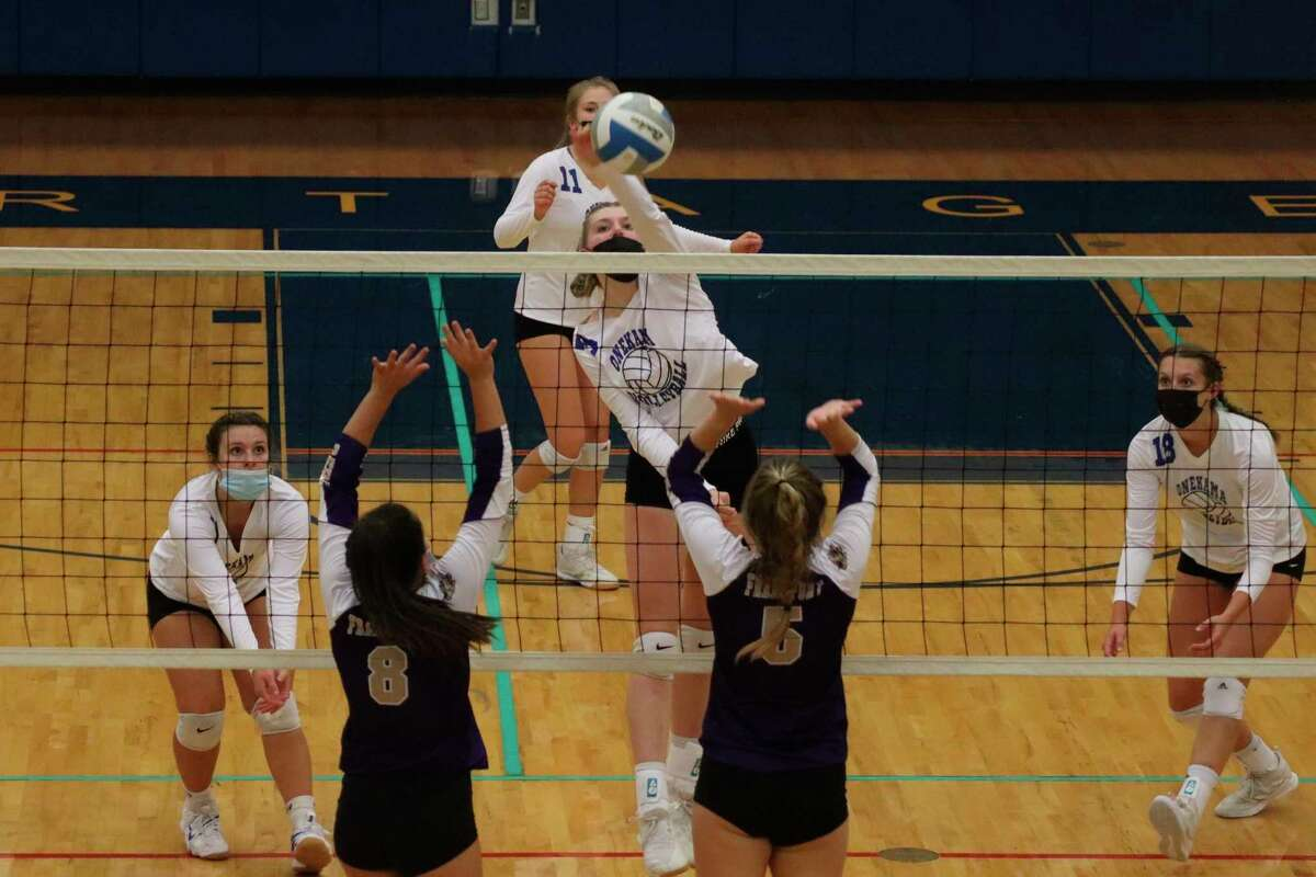 Mairin McCarthy delivers a big swing against the visiting Frankfort Panthers on Sept. 28. (Robert Myers/News Advocate)
