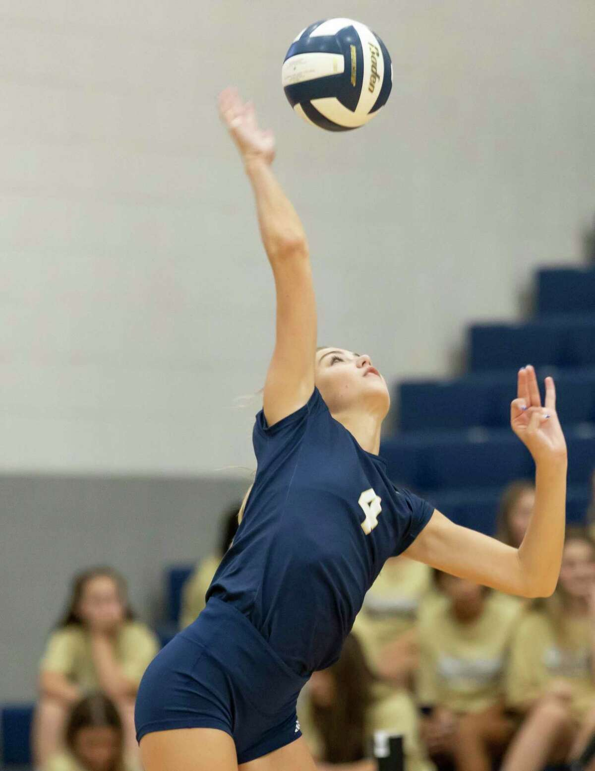 Payton Woods of Lake Creek (4) serves the ball during the first set of a District 20-5A match against Cleveland at Lake Creek High School, Tuesday, Sept. 28, 2021, in Montgomery.