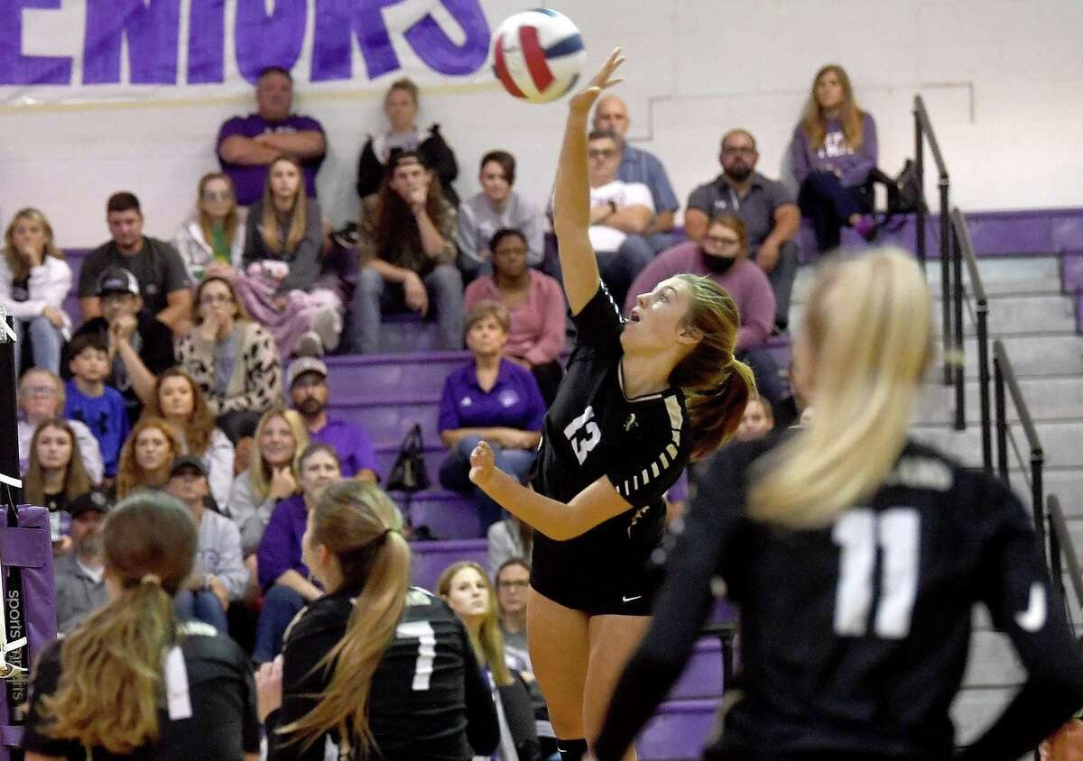 Port Neches-Groves moves to block as Nederland's Reagan Friesz spikes the ball during their Mid-County Madness volleyball match-up Tuesday at PNG. Photo made Tuesday, September 28, 2021 Kim Brent/The Enterprise