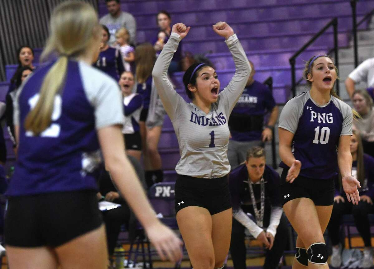 Port Neches-Groves. celebrates a score against Nederland during their Mid-County Madness volleyball match-up Tuesday at PNG. Photo made Tuesday, September 28, 2021 Kim Brent/The Enterprise