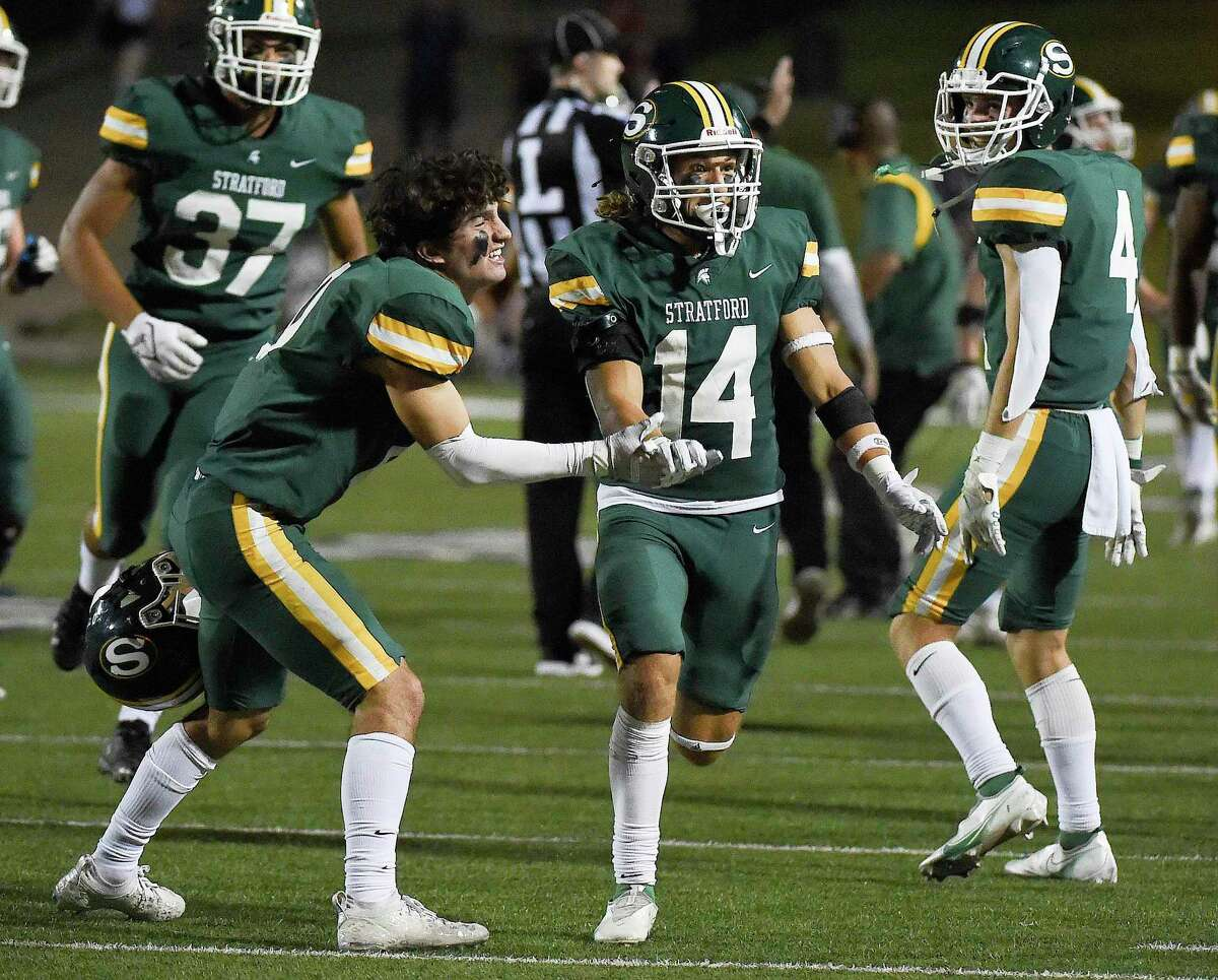 Stratford defensive back Perry Pope (14) celebrates his interception with Jake Brand, left, late in the fourth quarter of a high school football game against Cy-Fair, Friday, Sept. 24, 2021, in Houston.