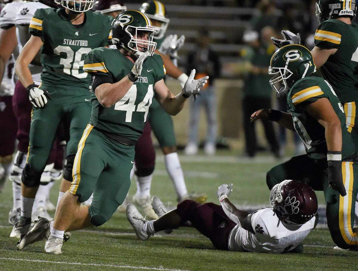 Stratford linebacker Cooper King, left, celebrates his tackle of Cy-Fair running back Zaccheas Baynes, bottom right, for a loss during the second half of a high school football game, Friday, Sept. 24, 2021, in Houston.