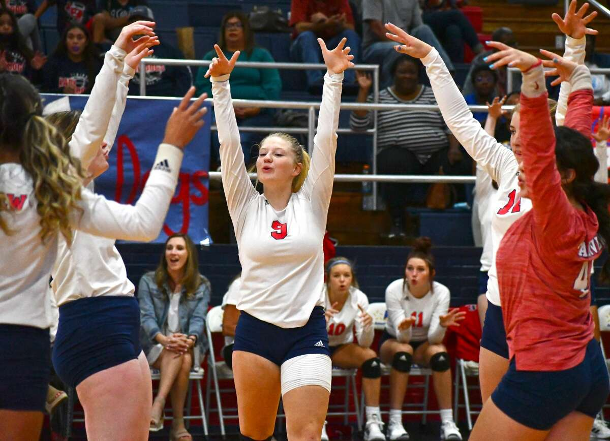 Haley Curtis and members of the Plainview volleyball team celebrate a point during their 3-0 sweep of Amarillo Palo Duro in a District 3-5A contest on Tuesday in the Dog House.