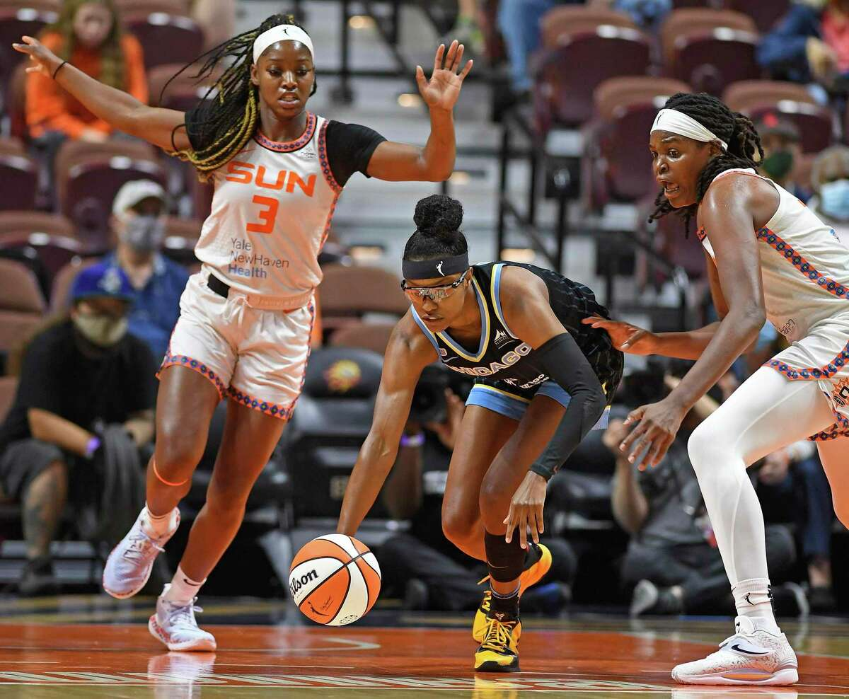 Chicago Sky guard Diamond DeShields, middle, gets control of the ball under pressure from Connecticut Sun defenders Kaila Charles (3) and Jonqel Jones, right, during a WNBA playoff basketball game Tuesday, Sept. 28, 2021 at Mohegan Sun Arena in Uncasville, Conn. (Sean D. Elliot/The Day via AP)