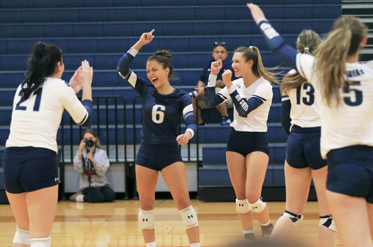 The Smithson Valley volleyball team celebrates after a winning point in the third game against East Central at Smithson Valley on Tuesday, Sept. 28, 2021. Smithson Valley defeated East Central in three straight sets to take the match.