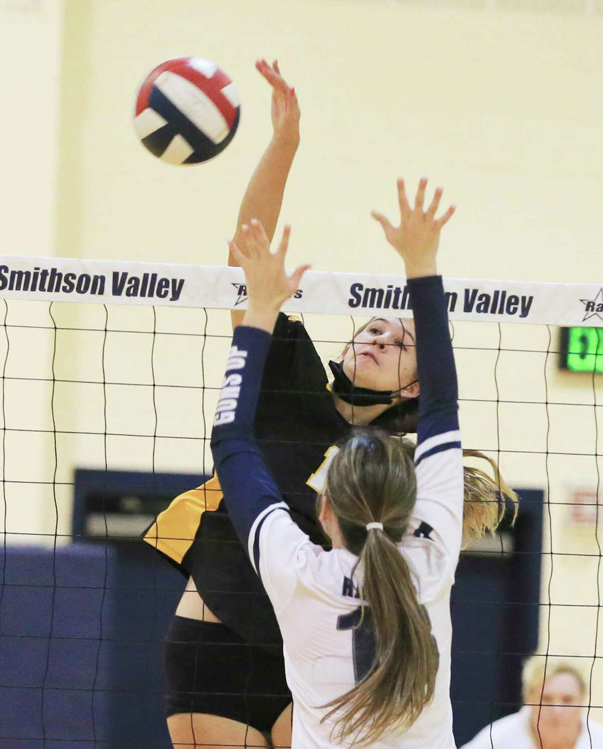 East Central's Nicole Pruski gets a kill over Smithson Valley's Lillie Johnson during their girls volleyball game at Smithson Valley on Tuesday, Sept. 28, 2021. Smithson Valley defeated East Central in three straight sets to take the match.