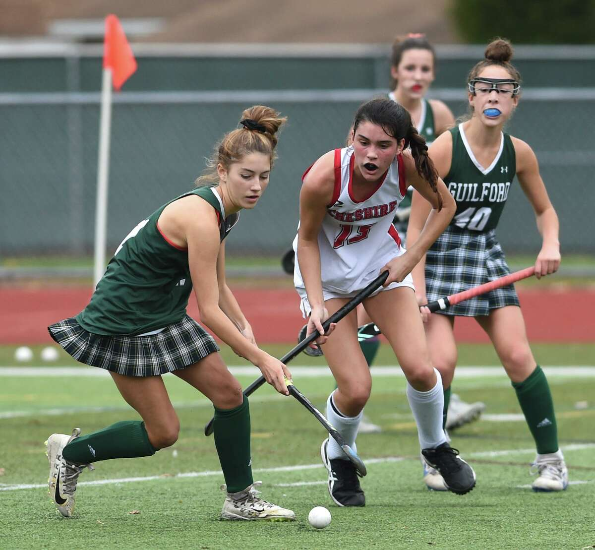 Guilford's Ella Clarke, left, and Cheshire's Lauren Houle fight for the ball in the SCC Division A field hockey championship at Cheshire High in 2020.
