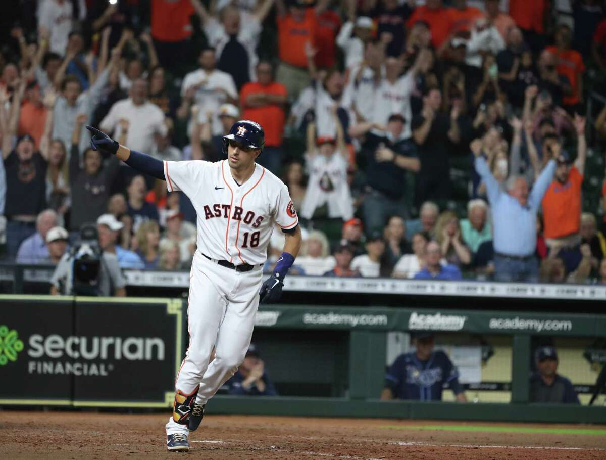 Astros catcher Jason Castro celebrates after drawing the bases-loaded walk that scored the winning run in Tuesday's 4-3 victory over the Rays at Minute Maid Park.