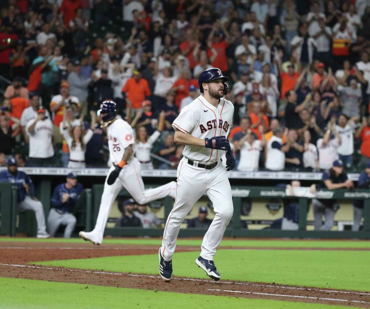 Houston Astros Chas McCormick (20) is walked scoring Jose Siri to tie the Tampa Bay Rays during the ninth inning of an MLB baseball game at Minute Maid Park, Tuesday, September 28, 2021, in Houston.