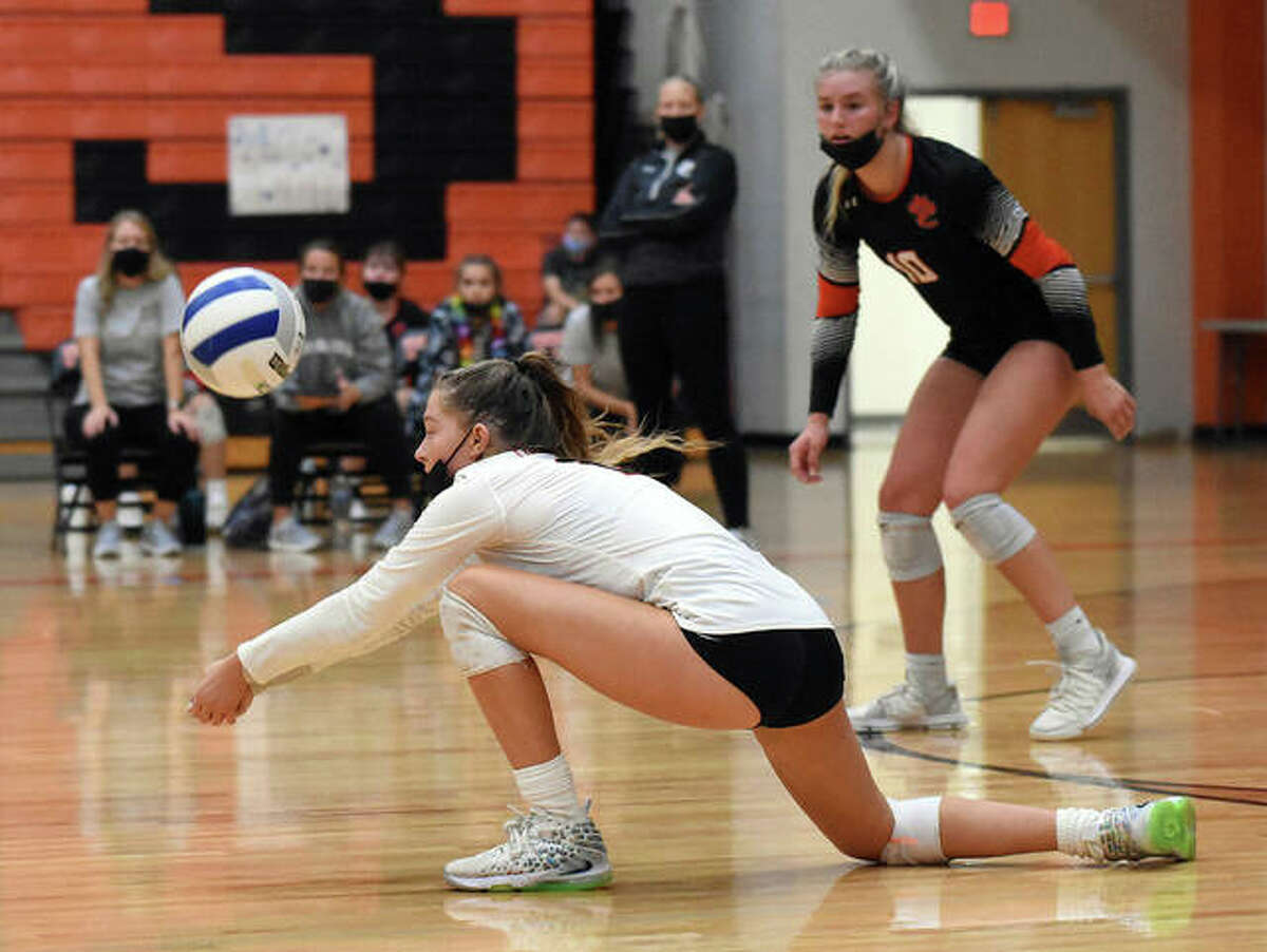 Edwardsville's Kaitlyn Conway receives a serve during the second game against O'Fallon on Tuesday inside Lucco-Jackson Gymnasium in Edwardsville.