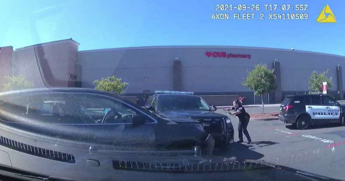 The moments before a man reported to be involved in a larceny rams a police cruiser while an officer was standing near the vehicle in Enfield, Conn., on Sunday, Sept. 26, 2021, according to police.