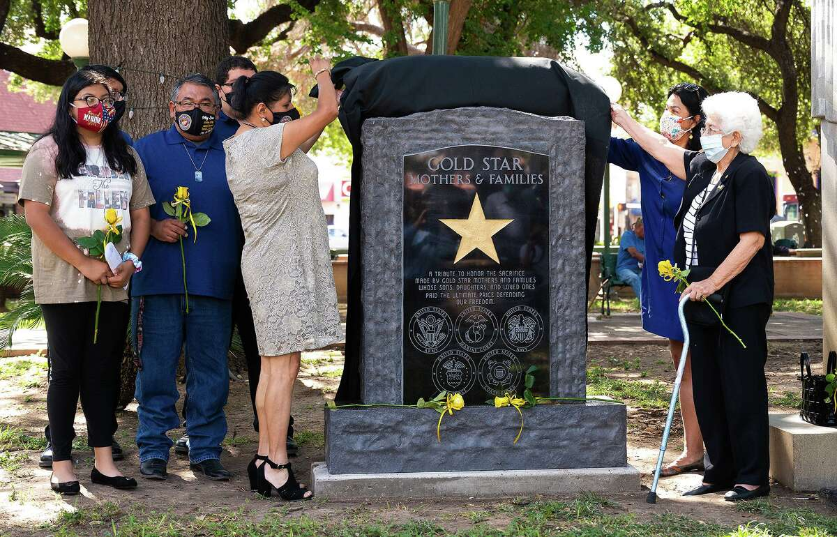 The Gold Star families of LCpl David Lee Espinoza and Cpt. Heriberto Garcia unveil the Gold Star Mothers & Families monument erected in honor of the families of service members who died while serving, Saturday, Sept. 25, 2021 during an observance of Gold Star Mothers Day at Jarvis Plaza.