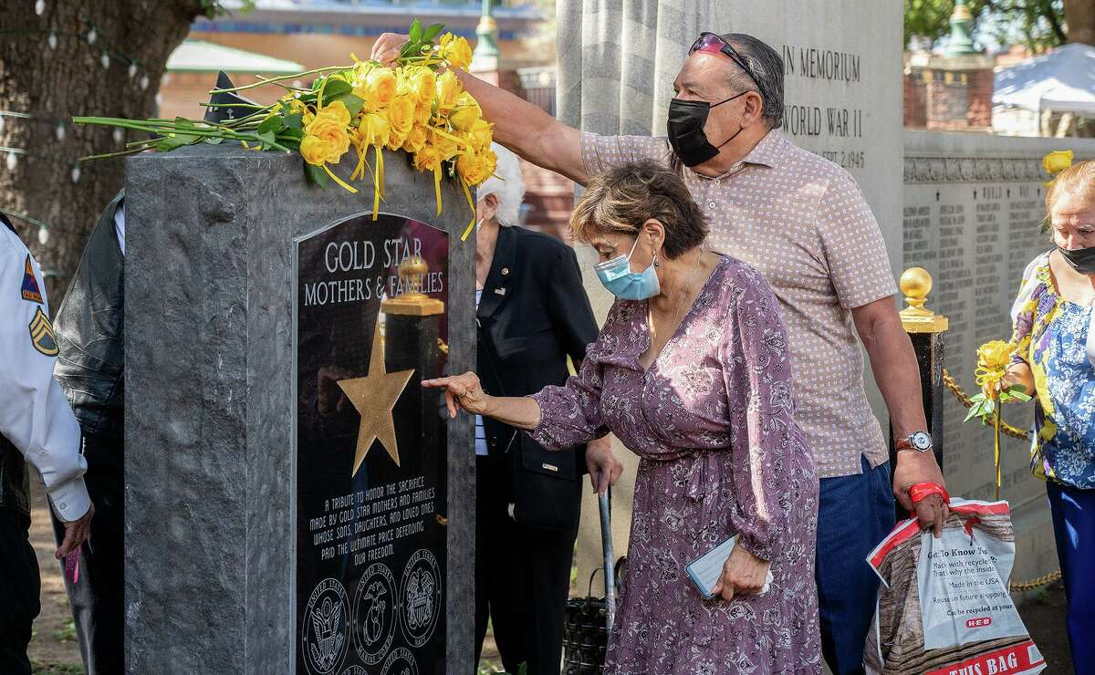 Gold Star Mothers, families and veterans gather at a monument erected in honor of the families of service members who died while serving, Saturday, Sept. 25, 2021 during an observance of Gold Star Mothers Day at Jarvis Plaza.