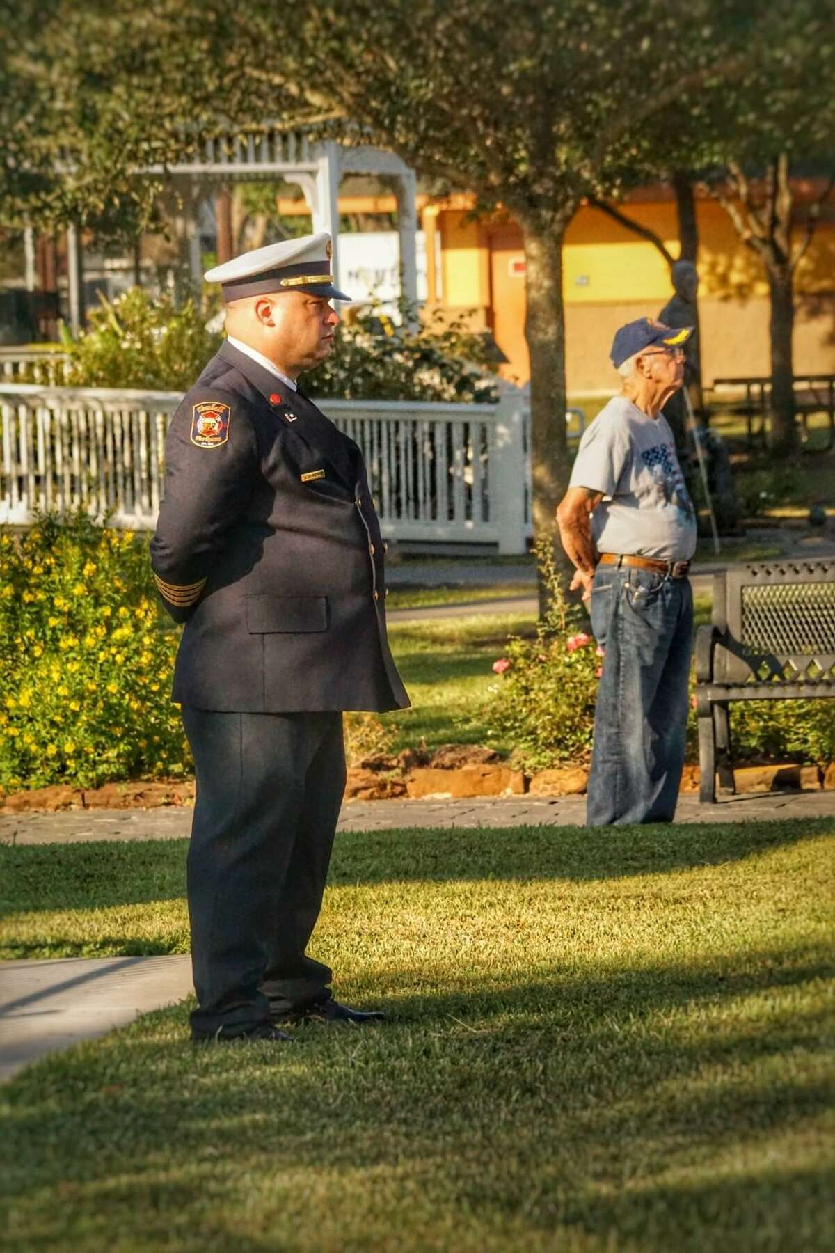 A photograph titled 'Generations' shows Tomball's new Fire Chief Joe Sykora (left) and a U.S. Navy veteran (right) during the city's 9/11 remembrance event Saturday, Sept. 11, 2021 at the depot.
