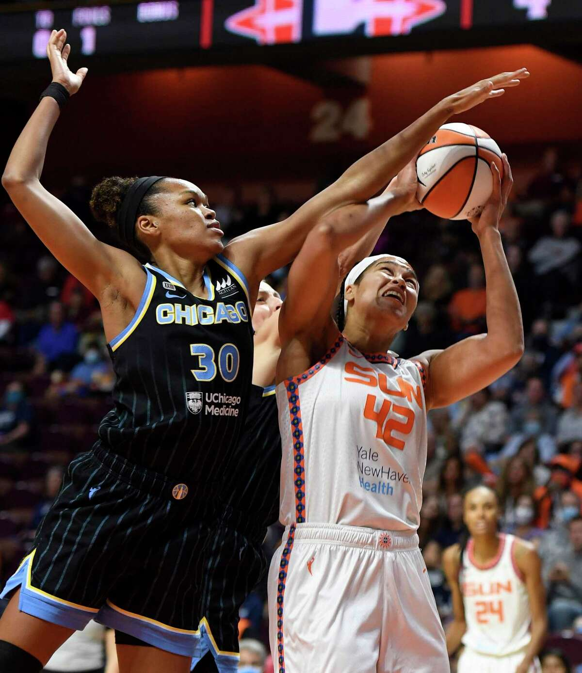 Connecticut Sun center Brionna Jones is fouled by Chicago Sky center Azura Stevens during a WNBA playoff basketball game Tuesday, Sept. 28, 2021 at Mohegan Sun Arena in Uncasville, Conn. (Sean D. Elliot/The Day via AP)