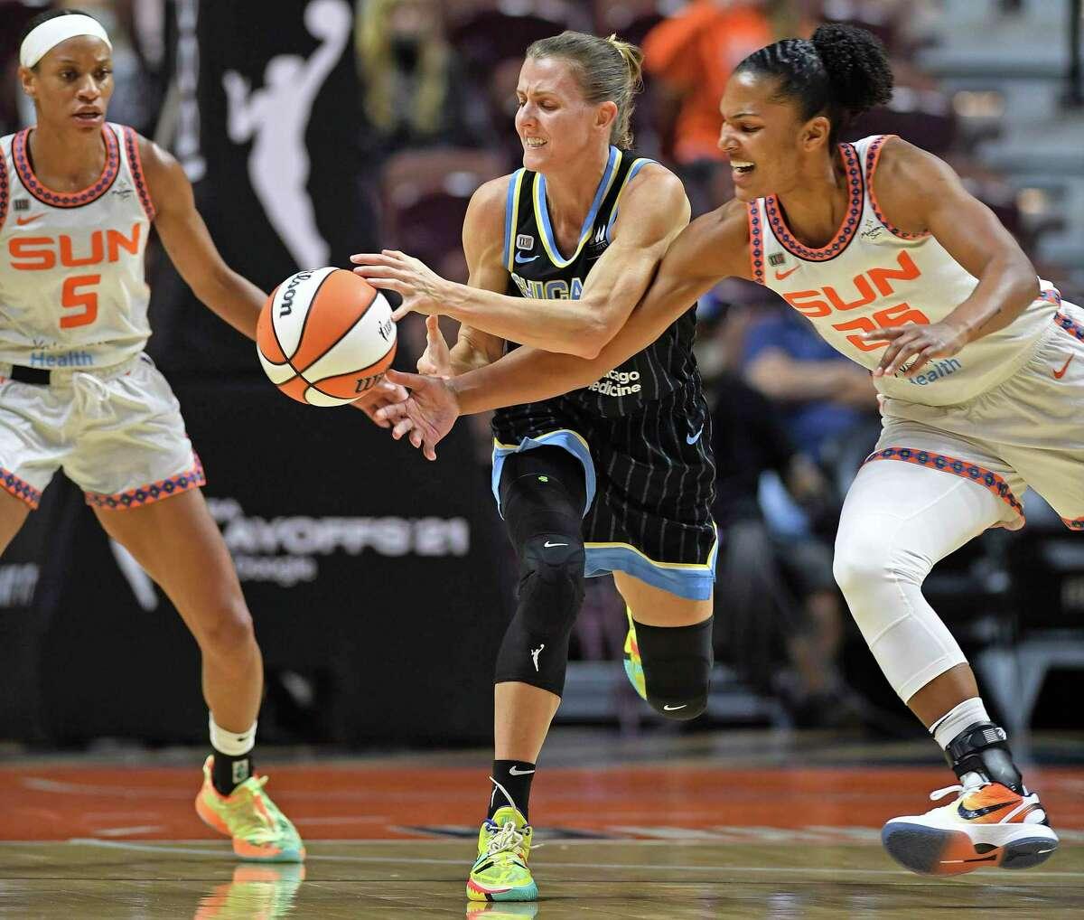 Connecticut Sun forward Alyssa Thomas (25) pokes the ball away from Chicago Sky guard Allie Quigley during a WNBA playoff basketball game Tuesday, Sept. 28, 2021 at Mohegan Sun Arena in Uncasville, Conn. (Sean D. Elliot/The Day via AP)