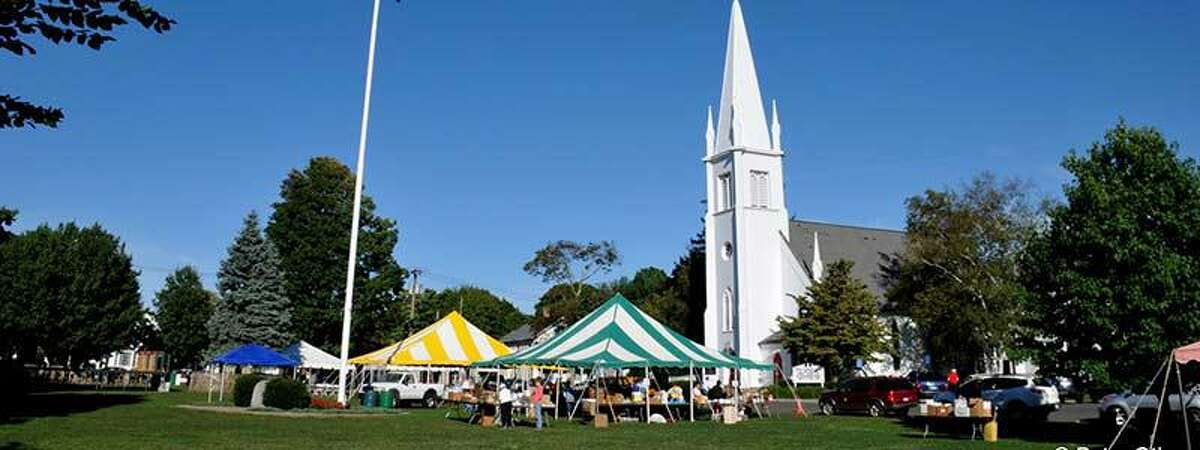 Shown here is a scene from a past Trinity Church Fair on the Branford Town Green.