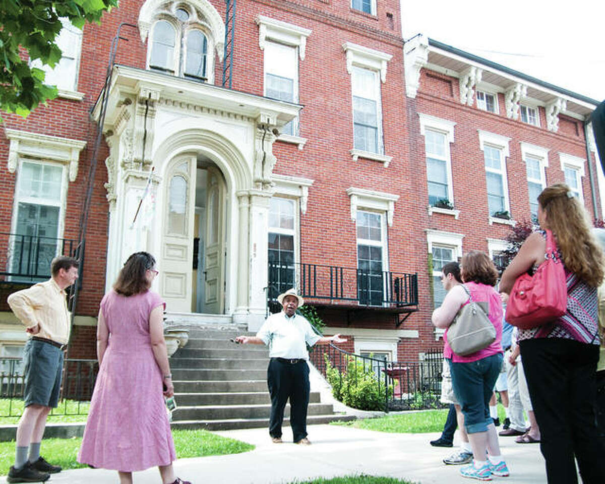 Historian J.R. Robinson, pictured here outside the Enos Apartments, will lead Underground Railroad Tours on Oct. 9 in Alton.