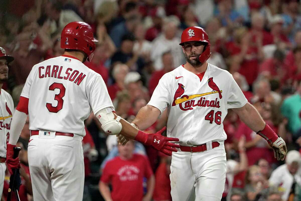 St. Louis Cardinals' Paul Goldschmidt (46) is congratulated by teammate Dylan Carlson (3) after scoring during the fifth inning of a baseball game against the Milwaukee Brewers Tuesday, Sept. 28, 2021, in St. Louis. (AP Photo/Jeff Roberson)