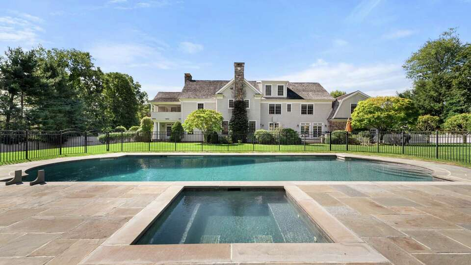 Westport home offers 4 floors of living and entertainment space