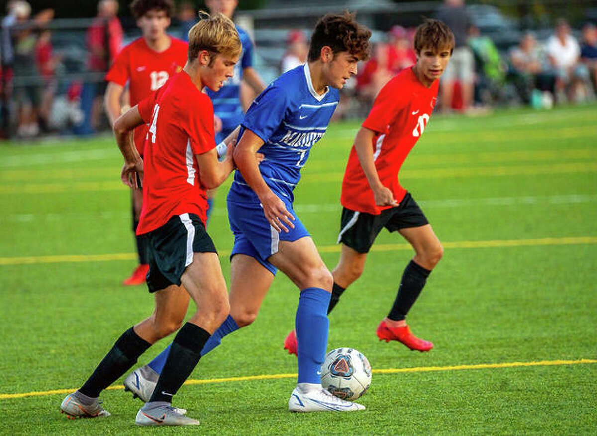 Marquette Myles Paniagua (in blue) scored three goals in his team's 7-0 victory over Highland Wednesday night. He is shown in action Tuesday against Alton High.