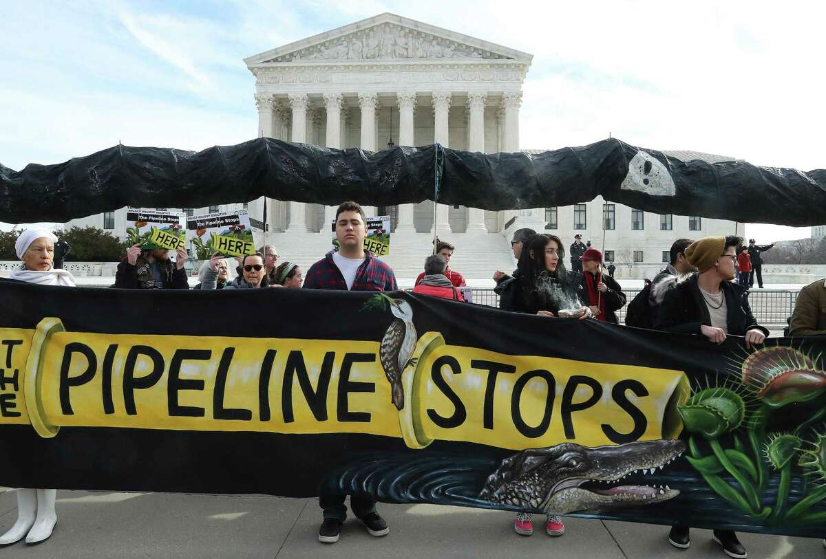 Climate activist groups protest in front of the U.S. Supreme Court as oral arguments are heard in U.S. Forest Service and Atlantic Coast Pipeline, LLC v. Cowpasture River Assn. case, on Feb. 24, 2020 in Washington, D.C. (Mark Wilson/Getty Images/TNS)